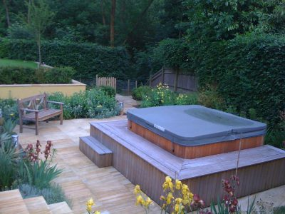 The sunken hot tub garden, the yew hedges are still to reach their mature height.