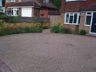 The front garden and sweeping new drive edged by generous planting