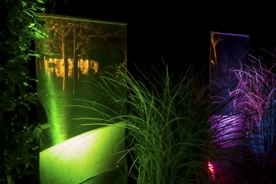 Garden sculptures lit with coloured lights