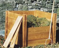 Adding boards to front of wooden compost bin