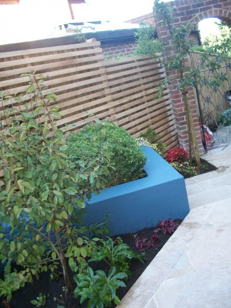 Blues and oranges in a chic modern courtyard garden in Brighton