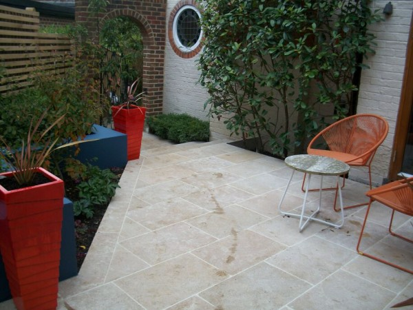 brillent oranges and elegant landscaping with a sawn stone terrace Brighton