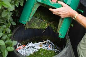 Adding shredded paper and grass clippings